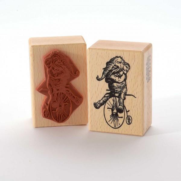 Motivstempel Titel: Elefant auf dem Fahrrad